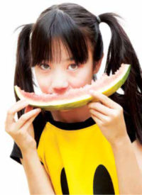 Teenager eating watermelon